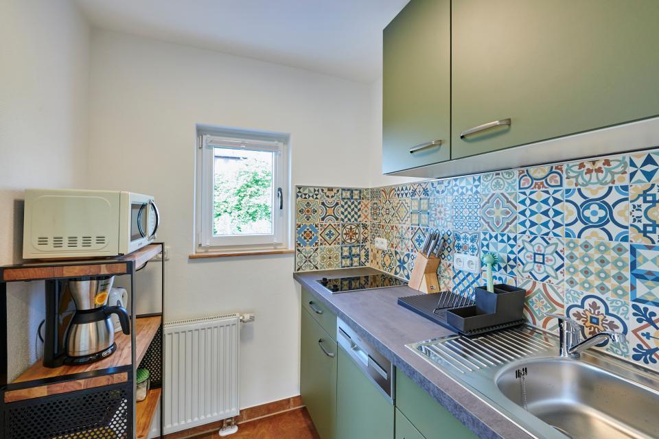 Die Küche mit echtem Fliesenspiegel. Wir haben großen Wert gelegt auf hochwertige Materialien mit tollem Design.